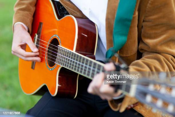man playing acoustic guitar - acoustic music stock pictures, royalty-free photos & images