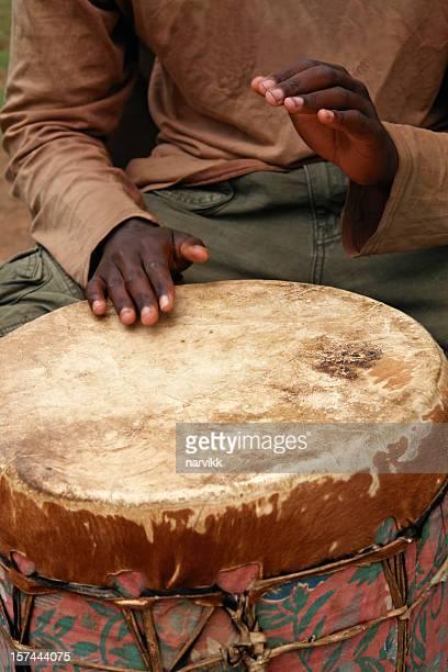 Man Playing African Drum