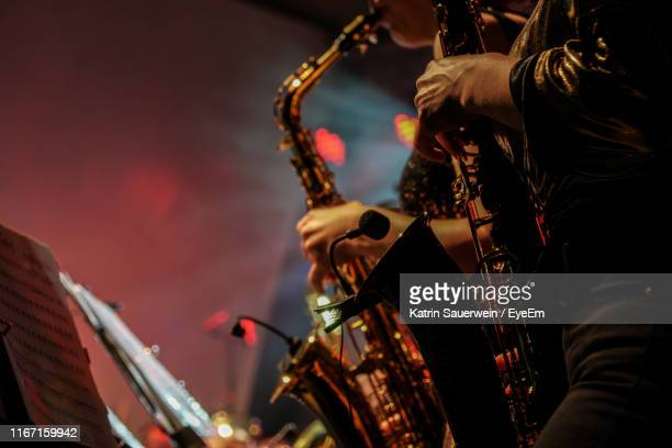 man playing at music concert - jazz stock pictures, royalty-free photos & images