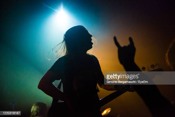 man playing at music concert - heavy metal stock pictures, royalty-free photos & images