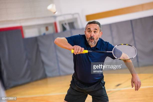 man playing badminton - racquet sport stock photos and pictures