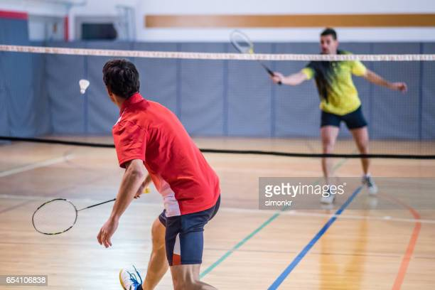 man playing badminton - badminton sport stock photos and pictures