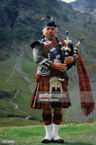Man Playing Bagpipes