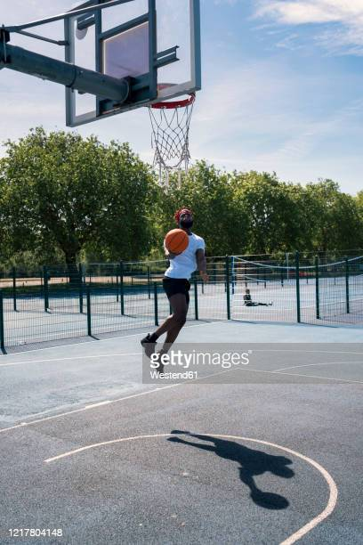 man playing basketball, dunking - try scoring stock pictures, royalty-free photos & images
