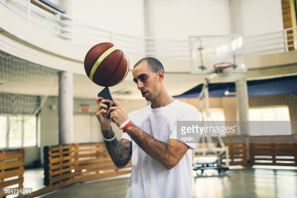 man playing basketball in a school gym - hitting stock pictures, royalty-free photos & images