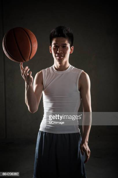Man playing basketball on Gray Background