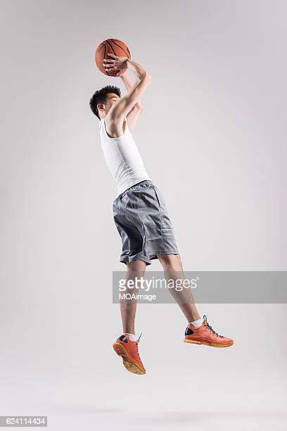 Man playing basketball on White Background