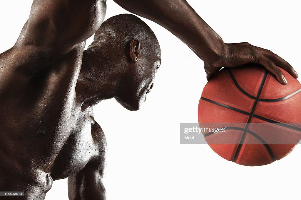 Man playing basketball : Stock Photo