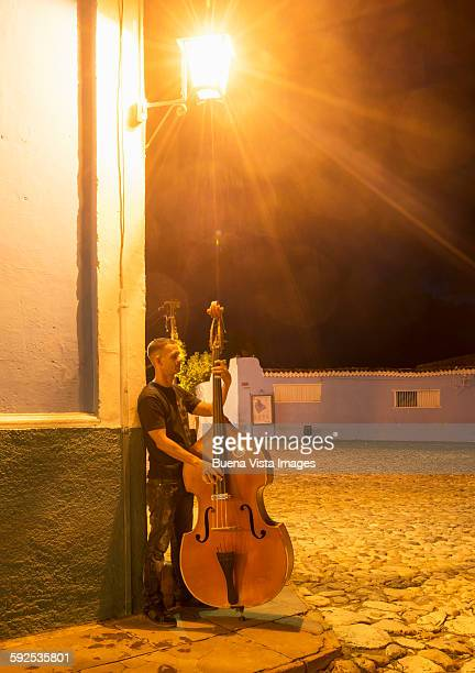Man playing bass in a colonial town