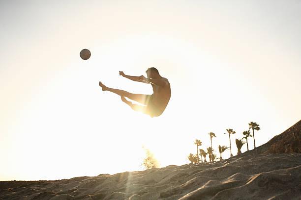 Man playing beach soccer