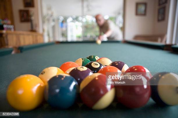 man playing billiards - old men playing pool stock pictures, royalty-free photos & images