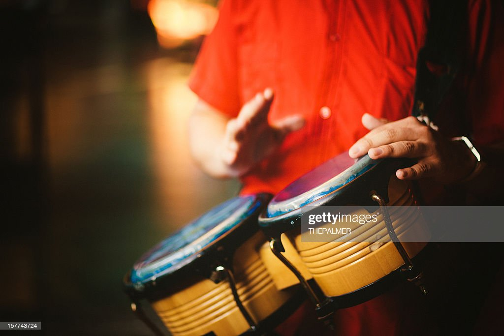 man playing bongos : Stock Photo