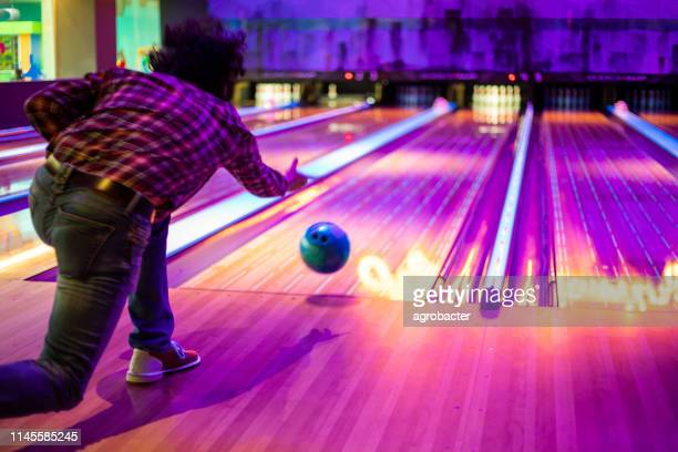 man playing bowling - bowling stock pictures, royalty-free photos & images