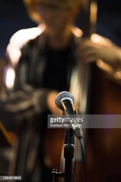man playing cello - microphone stand stock photos and pictures