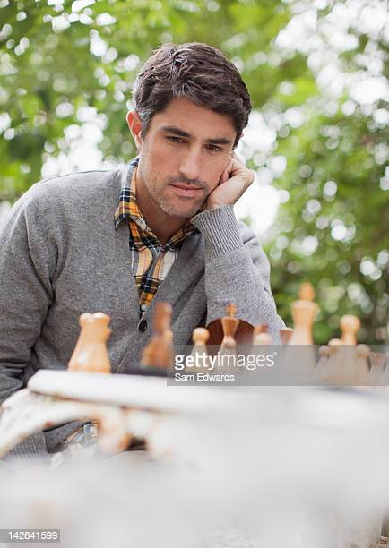 Man playing chess outdoors