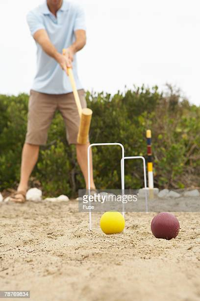 man playing croquet - percussion mallet stock pictures, royalty-free photos & images