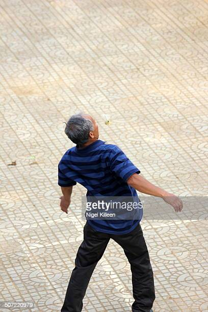 A man playing 'Da Cau' Vietnams national sport Da Cau also known as Jianzi in China is a traditional Asian game in which players aim to keep a...