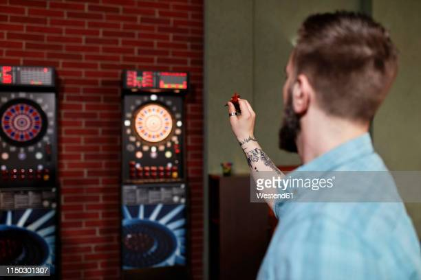 man playing darts - dart stock pictures, royalty-free photos & images