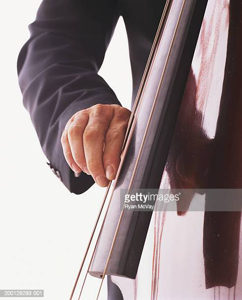 Man playing double bass, close-up