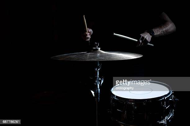 man playing drums and cymbal - percussion instrument stock photos and pictures