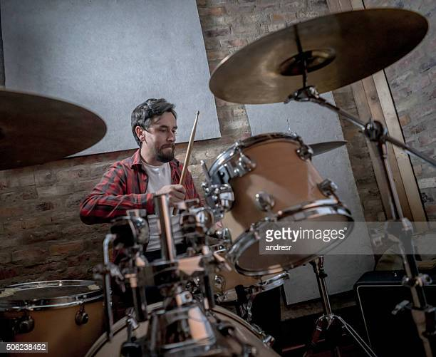 Man playing drums at a music studio