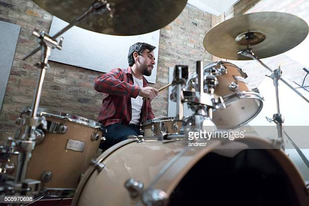 Man playing drums at a recording studio
