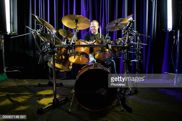 Man playing drums on stage, portrait,