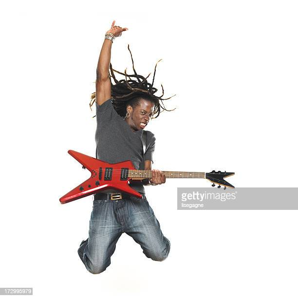 Man playing electric guitar and jumping