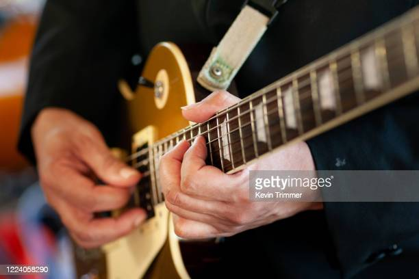 man playing electric guitar at concert - musical instrument string stock pictures, royalty-free photos & images