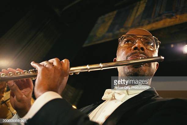 Man playing flute, close up