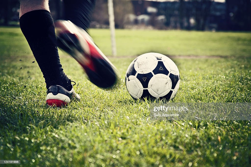 Man playing football : Photo