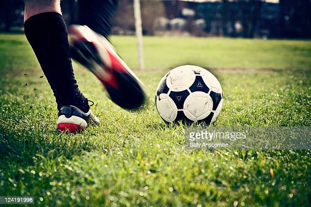 man playing football - kicking stock pictures, royalty-free photos & images