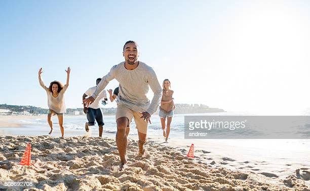 Man playing football with friends and celebrating a goal