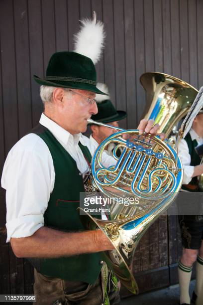 man playing french horn. - bavaria stock pictures, royalty-free photos & images