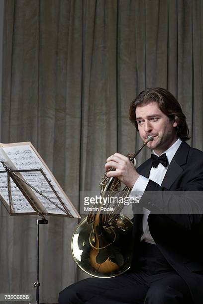 Man playing French horn, upper half