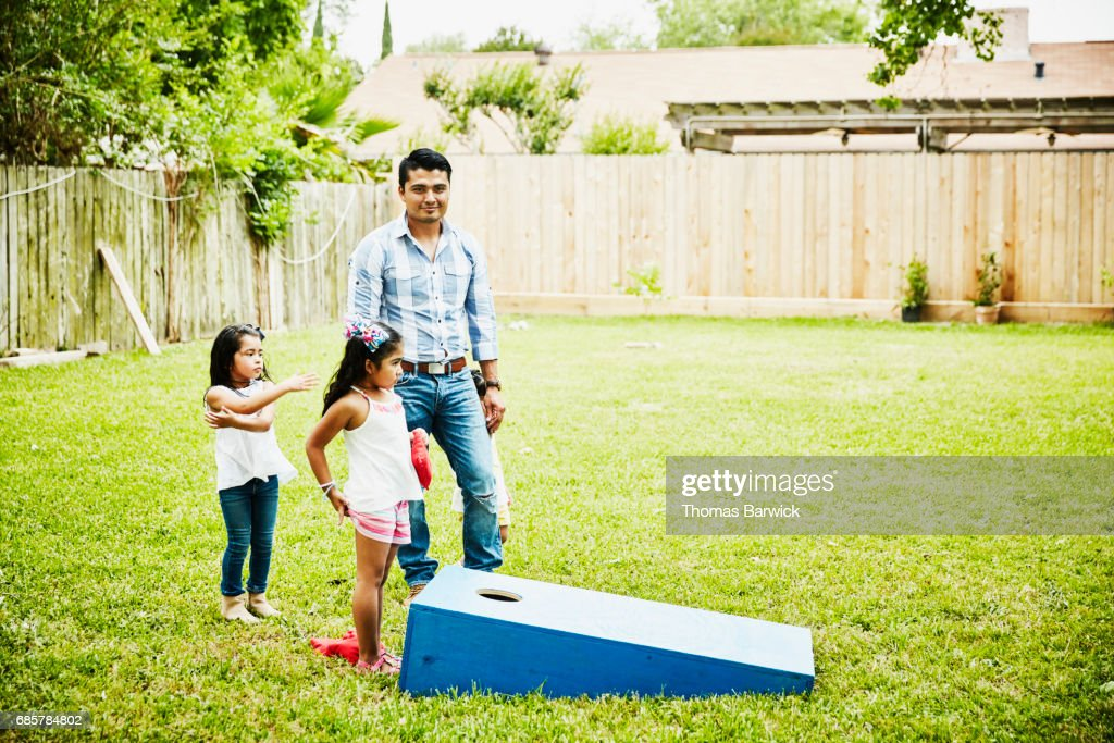 Man Playing Game With Nieces In Backyard During Birthday Party High Res Stock Photo Getty Images