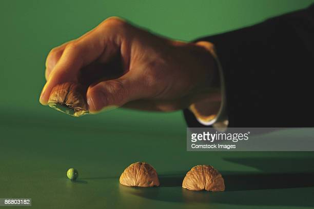 Man playing game with nutshells and pea