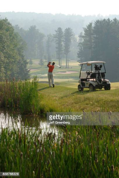 A man playing golf at Woodloch Springs Golf Course