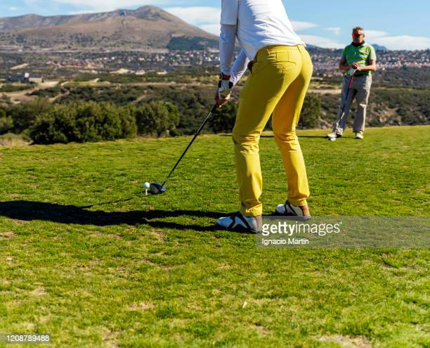 man playing golf, doing the practice swing, on a golf course in summer on a sunny day - ゴルフクラブ ドライバー ストックフォトと画像