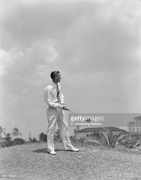 man playing golf golfing biltmore hotel miami florida men sport sports travel vacation retro. - biltmore hotel stock photos and pictures