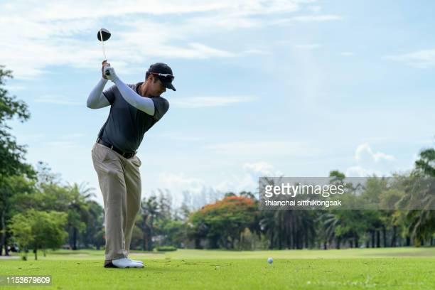 man playing golf in a golf course - ゴルフのスウィング ストックフォトと画像