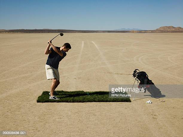 man playing golf in desert - el mirage dry lake stock photos and pictures