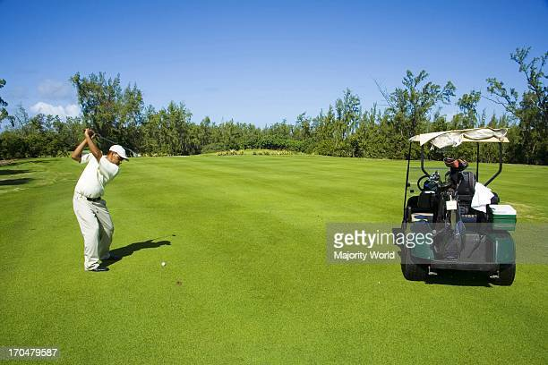 A man playing golf in Le Touessrok Golf course in Mauritius It is an island nation off the coast of the African continent in the southwest Indian...