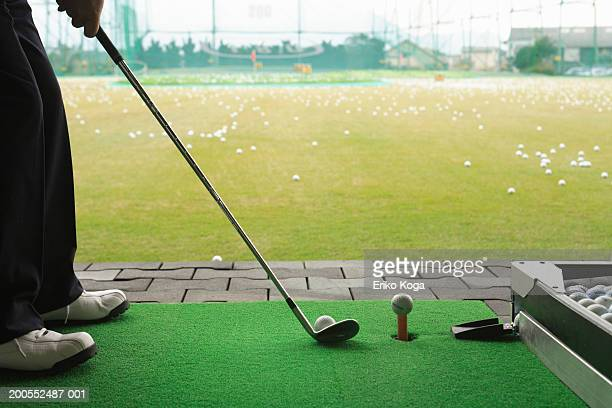 man playing golf, low section - driving range stock pictures, royalty-free photos & images