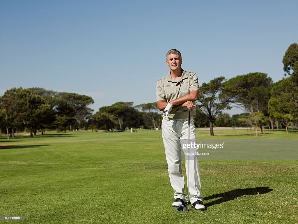 Man playing golf on golf course : Stock Photo