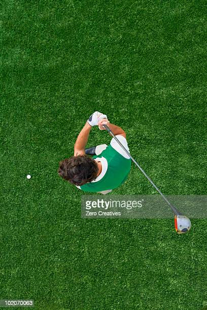 man playing golf - golfer stock pictures, royalty-free photos & images