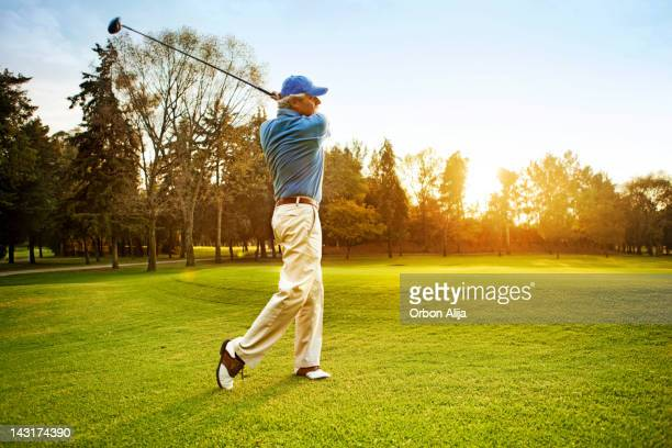 man playing golf - golf swing stock pictures, royalty-free photos & images