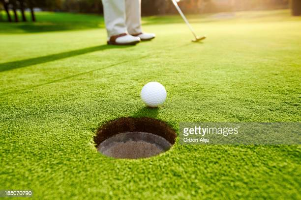 man playing golf - putting stock pictures, royalty-free photos & images