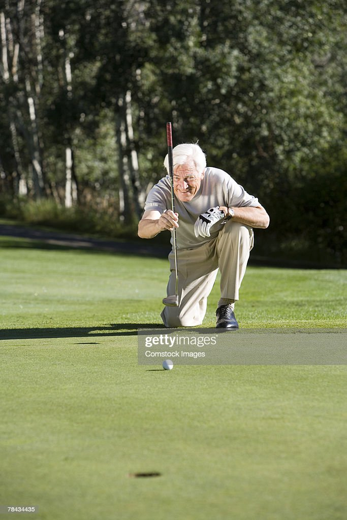 Man playing golf : Stockfoto