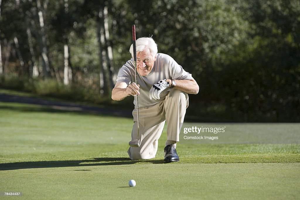 Man playing golf : Stockfoto